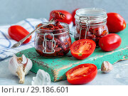 Sun-dried tomatoes with garlic, spices and olive oil. Стоковое фото, фотограф Марина Сапрунова / Фотобанк Лори