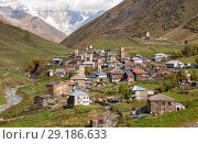 Купить «Ushguli mountain village with traditional Svan towers, Upper Svaneti, Georgia», фото № 29186633, снято 28 сентября 2018 г. (c) Юлия Бабкина / Фотобанк Лори