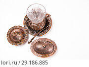 Купить «Turkish tea set. Ottoman teacup with traditional arabic ornaments on white background», фото № 29186885, снято 21 февраля 2016 г. (c) Евгений Ткачёв / Фотобанк Лори