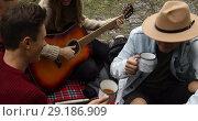 Купить «Group of people sitting on blanket and eating», видеоролик № 29186909, снято 30 августа 2018 г. (c) Ekaterina Demidova / Фотобанк Лори