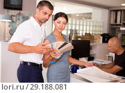 Купить «Couple looking for furnishing materials in store», фото № 29188081, снято 17 июля 2018 г. (c) Яков Филимонов / Фотобанк Лори