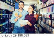 Купить «Couple with shop list in store», фото № 29188089, снято 16 февраля 2018 г. (c) Яков Филимонов / Фотобанк Лори