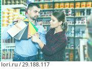 Купить «Two designer are looking sample of materials for repair», фото № 29188117, снято 16 февраля 2018 г. (c) Яков Филимонов / Фотобанк Лори