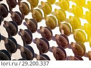 Купить «Metal folding chairs standing in lines outdoors», фото № 29200337, снято 27 июля 2017 г. (c) Сергей Новиков / Фотобанк Лори