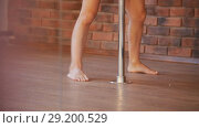Sexy girl in red dress prepares to training her pole dance. Стоковое видео, видеограф Константин Шишкин / Фотобанк Лори