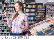 Купить «woman customer holding glass jar with color paint in art department», фото № 29200725, снято 12 апреля 2017 г. (c) Яков Филимонов / Фотобанк Лори