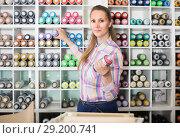 Купить «portrait of woman choosing paint color in aerosol can in art shop», фото № 29200741, снято 12 апреля 2017 г. (c) Яков Филимонов / Фотобанк Лори