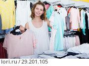 Купить «Woman shopping at the apparel store», фото № 29201105, снято 19 июня 2017 г. (c) Яков Филимонов / Фотобанк Лори
