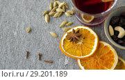 Купить «hot mulled wine, orange slices, raisins and spices», видеоролик № 29201189, снято 7 октября 2018 г. (c) Syda Productions / Фотобанк Лори