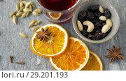 Купить «hot mulled wine, orange slices, raisins and spices», видеоролик № 29201193, снято 7 октября 2018 г. (c) Syda Productions / Фотобанк Лори