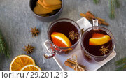 Купить «glasses of hot mulled wine with orange and spices», видеоролик № 29201213, снято 7 октября 2018 г. (c) Syda Productions / Фотобанк Лори