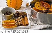 Купить «spices and hot mulled wine with orange slices», видеоролик № 29201393, снято 7 октября 2018 г. (c) Syda Productions / Фотобанк Лори