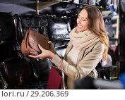 Купить «Excited female customer holding new handbag», фото № 29206369, снято 21 октября 2018 г. (c) Яков Филимонов / Фотобанк Лори
