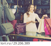 Купить «Portrait of woman selling wallets and purses», фото № 29206389, снято 27 января 2020 г. (c) Яков Филимонов / Фотобанк Лори