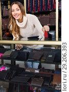 Купить «Portrait of woman selling wallets and purses», фото № 29206393, снято 21 октября 2018 г. (c) Яков Филимонов / Фотобанк Лори