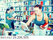 Купить «Girl looking for new literature», фото № 29206505, снято 16 сентября 2016 г. (c) Яков Филимонов / Фотобанк Лори