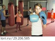 Купить «Child boxer in gloves posing during boxing», фото № 29206585, снято 12 апреля 2017 г. (c) Яков Филимонов / Фотобанк Лори