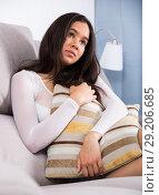 Купить «sad female sitting with pillow», фото № 29206685, снято 30 мая 2017 г. (c) Яков Филимонов / Фотобанк Лори