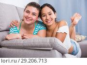 Two happy teenage girls on sofa. Стоковое фото, фотограф Яков Филимонов / Фотобанк Лори