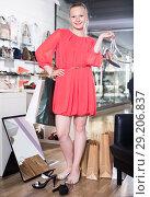 Купить «Adult female is showing summer brilliant shoes», фото № 29206837, снято 27 мая 2017 г. (c) Яков Филимонов / Фотобанк Лори
