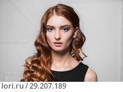 Купить «Portrait of beautiful curly woman», фото № 29207189, снято 3 ноября 2015 г. (c) Сергей Сухоруков / Фотобанк Лори