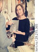 Купить «Cheerful female offering to buy necklace», фото № 29215365, снято 16 октября 2017 г. (c) Яков Филимонов / Фотобанк Лори