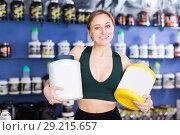 Купить «woman buying sport food supplements», фото № 29215657, снято 12 апреля 2018 г. (c) Яков Филимонов / Фотобанк Лори
