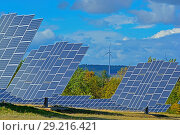 Купить «Solarpark Mengeringhausen with static Modules and Modules, that follow the Azimuth of the Sun. They produce electricity in any position and angle. Bad Arolsen, Hesse, Germany.», фото № 29216421, снято 11 сентября 2018 г. (c) age Fotostock / Фотобанк Лори
