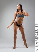 Купить «Fitness model in sports underwear view», фото № 29223421, снято 19 сентября 2018 г. (c) Гурьянов Андрей / Фотобанк Лори
