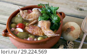 Купить «Solyanka with quails, ham, olives, quail eggs and pickled cucumbers on broth from quail served in clay pot», видеоролик № 29224569, снято 27 августа 2018 г. (c) Яков Филимонов / Фотобанк Лори