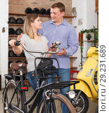 Купить «Portrait adult couple standing near bicycle», фото № 29231689, снято 8 мая 2018 г. (c) Яков Филимонов / Фотобанк Лори