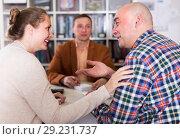Купить «Glad shop assistant working with customer», фото № 29231737, снято 4 апреля 2017 г. (c) Яков Филимонов / Фотобанк Лори