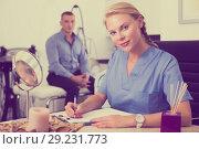 Купить «Female doctor is writing the conclusion about result of examination of client», фото № 29231773, снято 21 февраля 2019 г. (c) Яков Филимонов / Фотобанк Лори