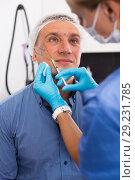 Купить «Female specialist is doing injection to client for anti-aging», фото № 29231785, снято 19 октября 2018 г. (c) Яков Филимонов / Фотобанк Лори