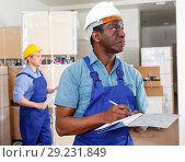 Купить «African-American contractor determining scope of building work», фото № 29231849, снято 4 мая 2018 г. (c) Яков Филимонов / Фотобанк Лори