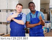Купить «Two confident construction workers», фото № 29231861, снято 4 мая 2018 г. (c) Яков Филимонов / Фотобанк Лори