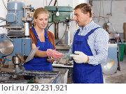 Woman with male colleague working on glass drilling machine. Стоковое фото, фотограф Яков Филимонов / Фотобанк Лори