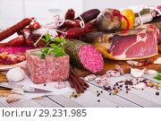 Купить «Variety of meats on table», фото № 29231985, снято 17 октября 2018 г. (c) Яков Филимонов / Фотобанк Лори