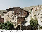 Купить «Picturesque stony houses in ordinary spanish town», фото № 29232037, снято 24 августа 2013 г. (c) Яков Филимонов / Фотобанк Лори
