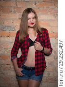 Купить «Young playful blond woman», фото № 29232497, снято 5 сентября 2015 г. (c) Сергей Сухоруков / Фотобанк Лори