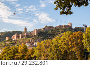 Купить «View of Narikala fortress on sunny autumn day. Tbilisi, Georgia», фото № 29232801, снято 3 октября 2018 г. (c) Юлия Бабкина / Фотобанк Лори