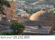 Купить «Domes of sulfur baths in historic district of Abanotubani, Tbilisi, Georgia», фото № 29232805, снято 3 октября 2018 г. (c) Юлия Бабкина / Фотобанк Лори