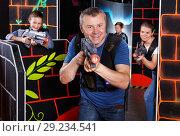 Купить «Man with laser pistol playing laser tag», фото № 29234541, снято 3 сентября 2018 г. (c) Яков Филимонов / Фотобанк Лори