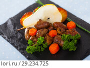 Купить «Fried chicken hearts with baked vegetables and fresh pear», фото № 29234725, снято 10 декабря 2018 г. (c) Яков Филимонов / Фотобанк Лори