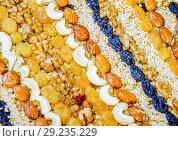 Купить «Kozinaki covered with nuts and seeds. Almonds, cashews and raisins.», фото № 29235229, снято 26 марта 2019 г. (c) Леонид Еремейчук / Фотобанк Лори