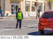 Купить «Russia, Samara, May 2018: Traffic woman on the street.», фото № 29236189, снято 5 мая 2018 г. (c) Акиньшин Владимир / Фотобанк Лори