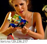 Купить «Burning photography wedding memories. Broken heart woman. Family break up.», фото № 29236217, снято 16 октября 2018 г. (c) Gennadiy Poznyakov / Фотобанк Лори