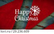 Happy Christmas text and Santa hats. Стоковое видео, агентство Wavebreak Media / Фотобанк Лори