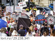 Купить «Florida, Miami, demonstration demonstrating protest protesting, Families Belong Together Free Children illegal immigration, Mexican border family separations, holding signs posters, crowd chanting,», фото № 29238341, снято 30 июня 2018 г. (c) age Fotostock / Фотобанк Лори