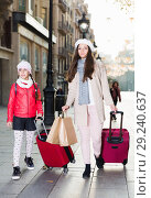 Купить «female and child girl going with baggage», фото № 29240637, снято 19 ноября 2017 г. (c) Яков Филимонов / Фотобанк Лори